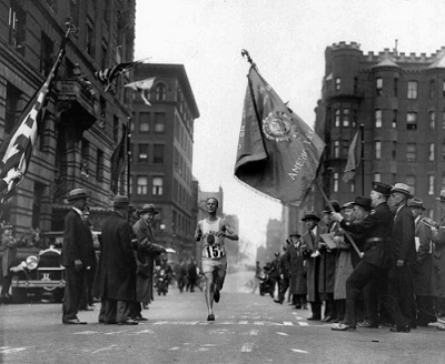 Veteran marathoner Clarence DeMar of the Melrose American Legion Post crosses the finish line April 19, 1930 in Boston, Mass., to win the Boston Marathon for the last of his record seven wins.  DeMar's time was 2:34:48.2. (AP Photo)