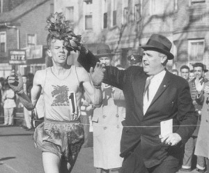 BOSTON - APRIL 20: John J. Kelley is presented the winners wreath by John Melia in the 1957 marathon. (Photo by Jack Sheahan/The Boston Globe via Getty Images)