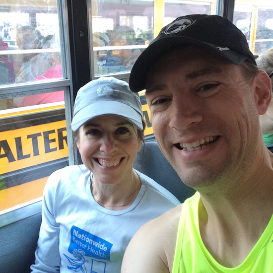 On the bus to Athletes' Village with my running partner, Cindy Warner